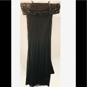 Strapless Black beaded evening gown; draped back